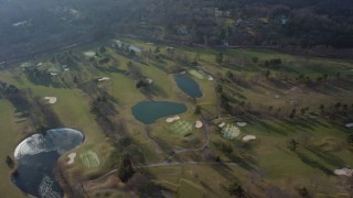 AX65_0017 - 5K stock footage aerial video of a bird's eye view of Tam O'Shanter Golf Club in Brookville, Long Island, New York, winter