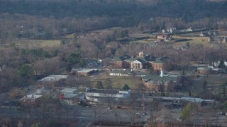 AX65_0020 - 5K stock footage aerial video of library at LIU Post in Brookville, Long Island, New York, winter