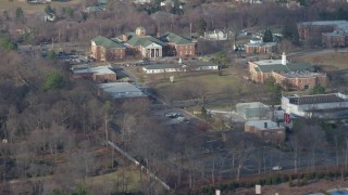 AX65_0021 - Aerial stock footage of 5K Aerial Video Track library and campus buildings at LIU Post in Brookville, Long Island, New York, winter