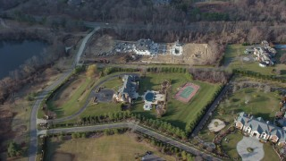 AX65_0022 - Aerial stock footage of 5K Aerial Video Tilt and pass by large mansions in Greenvale, Long Island, New York, winter