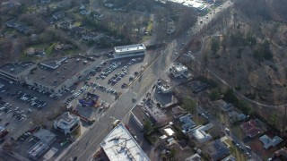AX65_0023 - Aerial stock footage of 5K Aerial Video Passing Northern Boulevard between car dealerships and Roslyn Cemetery in Greenvale, Long Island, New York, winter