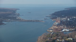 AX65_0024 - 5K stock footage aerial video of Hempstead Harbor and a power plant with smoke stacks on the shore in Glenwood Landing, Long Island, New York, winter