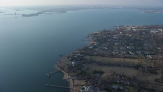 AX65_0027 - 5K stock footage aerial video of upscale, waterfront homes by Little Neck Bay in Great Neck, Long Island, New York, winter