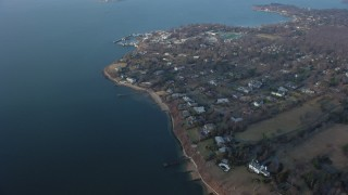 AX65_0028 - 5K stock footage aerial video of upscale, bayfront homes by Little Neck Bay in Great Neck, Long Island, New York, winter