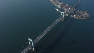 AX65_0031 - 5K stock footage aerial video bird's eye view of cars crossing Throgs Neck Bridge spanning the East River, Long Island, New York, winter