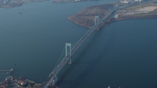 AX65_0033 - 5K stock footage aerial video flyby the Bronx Whitestone Bridge spanning the East River, Long Island, New York, winter