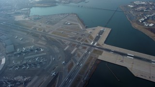 AX65_0037 - 5K stock footage aerial video of a bird's eye view of LaGuardia Airport, Queens, New York City, winter