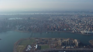 AX65_0042 - 5K stock footage aerial video approach public housing, urban neighborhoods, and Central Park, Upper East Side, Harlem, New York City, winter