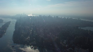 AX65_0043 - 5K stock footage aerial video of a view of Midtown Manhattan seen from the Upper East Side, New York City, winter