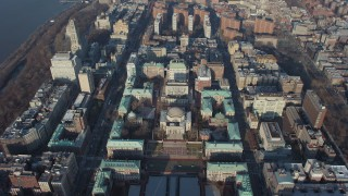 AX65_0049 - 5K stock footage aerial video tilt to a bird's eye view of Low Memorial Library on the Columbia University campus in New York City, winter