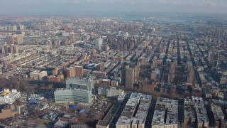 AX65_0051 - Aerial stock footage of Urban neighborhoods in Harlem and office buildings in Manhattanville, New York City, winter