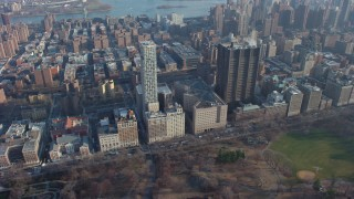 AX65_0055 - 5K stock footage aerial video flyby Mount Sinai Hospital and apartment buildings, Upper East Side, New York City, winter
