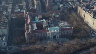 AX65_0057 - 5K stock footage aerial video track the Museum of Natural History, Upper West Side, New York City, winter