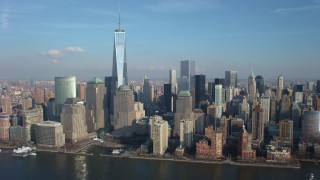 AX65_0073 - 5K stock footage aerial video slow flyby of Freedom Tower and World Trade Center skyscrapers in Lower Manhattan, New York City, winter