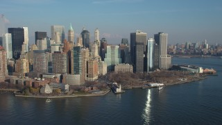 AX65_0097 - 5K stock footage aerial video of flying by Battery Park and the Lower Manhattan skyline, New York City, winter