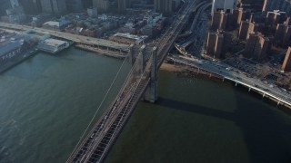 AX65_0105 - 5K stock footage aerial video of heavy traffic leaving Lower Manhattan on the Brooklyn Bridge, New York City, winter