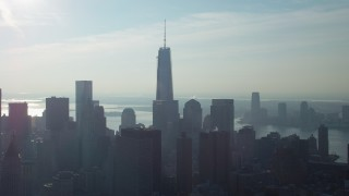 AX65_0108 - 5K stock footage aerial video of One World Trade Center towering over Lower Manhattan high-rises and skyscrapers, New York City, winter