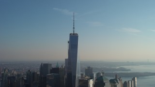 AX65_0112 - 5K stock footage aerial video orbit the top of One World Trade Center in Lower Manhattan, New York City, winter