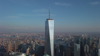 AX65_0114 - 5K stock footage aerial video of an orbit of Freedom Tower with the sun reflecting off the building in Lower Manhattan, New York City, winter