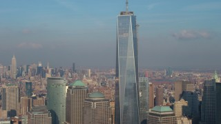 AX65_0115 - 5K stock footage aerial video tilt up to the spire atop Freedom Tower in Lower Manhattan, New York City, winter