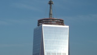 AX65_0117 - 5K stock footage aerial video close-up orbit of the top of Freedom Tower in Lower Manhattan, New York City, winter
