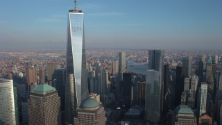AX65_0124 - 5K stock footage aerial video reverse view of Freedom Tower in Lower Manhattan, New York City, winter