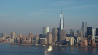 AX65_0126 - 5K stock footage aerial video of Freedom Tower and the Lower Manhattan skyline, reveal Goldman Sachs Tower, New York City, winter