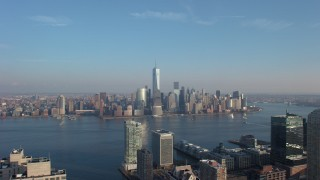 AX65_0130 - 5K stock footage aerial video of Lower Manhattan skyline seen from across the Hudson River, New York City, winter