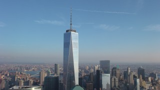 AX65_0136 - 5K stock footage aerial video orbit One World Trade Center with sun reflecting on skyscraper in winter, New York City, winter