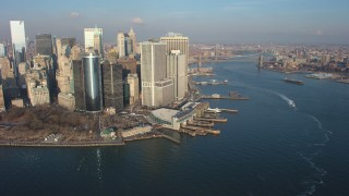 AX65_0140 - 5K stock footage aerial video of Lower Manhattan skyscrapers, Battery Park, and the East River, New York City, winter