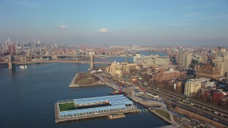 AX65_0142 - 5K stock footage aerial video follow Brooklyn Queens Expressway to approach the Brooklyn Bridge, New York City, winter