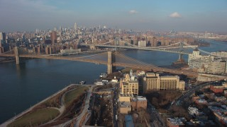 AX65_0143 - 5K stock footage aerial video approach the Brooklyn Bridge with heavy traffic, New York City, winter