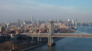 AX65_0157 - 5K stock footage aerial video of light traffic on the Williamsburg Bridge, with Midtown Manhattan skyline in the background, New York City, winter