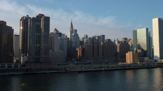 AX65_0166 - 5K stock footage aerial video fly low by riverfront condominium complexes in Midtown Manhattan, New York City, winter