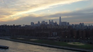 AX65_0171 - 5K stock footage aerial video of Lower Manhattan skyline seen from public housing by the East River on the Lower East Side, New York City, winter, sunset