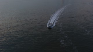 AX65_0182 - 5K stock footage aerial video track a NY Waterways ferry sailing New York Harbor, winter, twilight