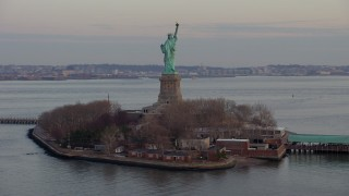 AX65_0186 - 5K stock footage aerial video orbit the Statue of Liberty monument on Liberty Island in New York, winter, twilight