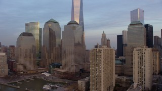 AX65_0194 - 5K stock footage aerial video flyby World Trade Center skyscrapers  and tilt to the top of Freedom Tower in New York City, winter, sunset