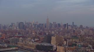 AX65_0196 - 5K stock footage aerial video of Midtown Manhattan skyline seen from Greenwich Village, New York City, winter, sunset