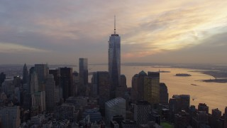 AX65_0199 - 5K stock footage aerial video orbit One World Trade Center tower, Lower Manhattan skyscrapers, New York City, winter, sunset