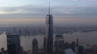 AX65_0203 - 5K stock footage aerial video of orbiting Freedom Tower in Lower Manhattan with Hudson River in the background, New York City, winter, sunset