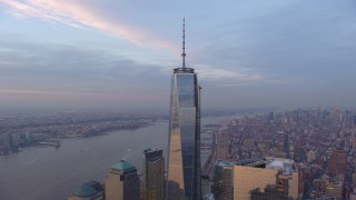 AX65_0204 - 5K stock footage aerial video an orbit of Freedom Tower in Lower Manhattan with Hudson River and Midtown in the background, New York City, winter, sunset