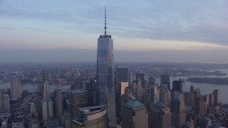 AX65_0209 - 5K stock footage aerial video flyby One World Trade Center and World Trade Center skyscrapers Lower Manhattan, New York City, winter, twilight