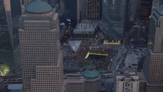 AX65_0211 - 5K stock footage aerial video flyby the World Trade Center Memorial in Lower Manhattan, New York City, winter, twilight