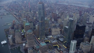 AX65_0217 - 5K stock footage aerial video of Freedom Tower and World Trade Center Memorial in Lower Manhattan, New York City, winter, twilight