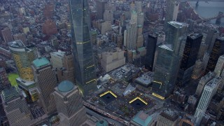 AX65_0218 - 5K stock footage aerial video of bird's eye of World Trade Center Memorial, tilt up to Freedom Tower in Lower Manhattan, New York City, winter, twilight