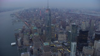 AX65_0226 - 5K stock footage aerial video orbit Freedom Tower in Lower Manhattan, New York City, with a view across Manhattan, winter, twilight