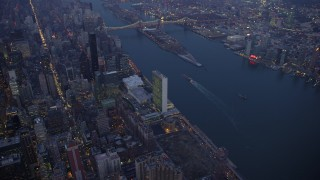 AX65_0248 - 5K stock footage aerial video of United Nations and Midtown Manhattan skyscrapers by the East River, New York City, winter, twilight