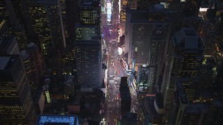 AX65_0258 - Aerial stock footage of Tilt to a bird's eye view of traffic in Times Square, Midtown Manhattan, New York City, winter, night