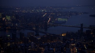 AX65_0263 - 5K stock footage aerial video of the Manhattan and Brooklyn Bridges spanning East River, New York City, winter, twilight